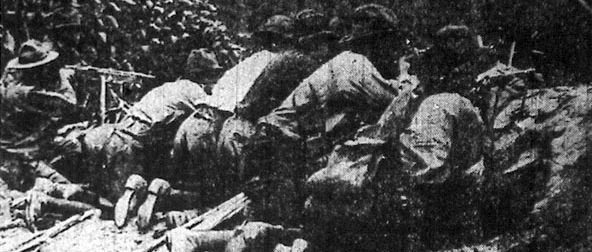 County deputies fire on miners from a Blair Mountain bluff in 1921.