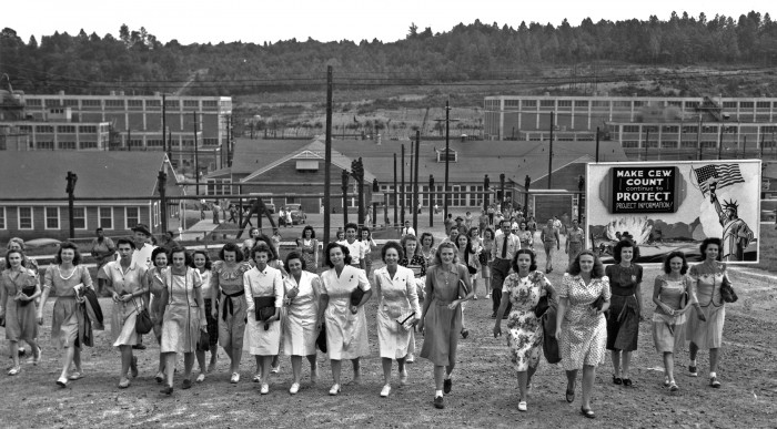 Workers leaving an Oak Ridge plant at shift change