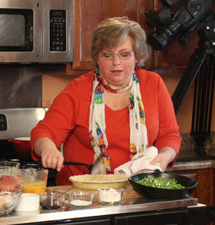 Joyce Pinson cooking on camera.