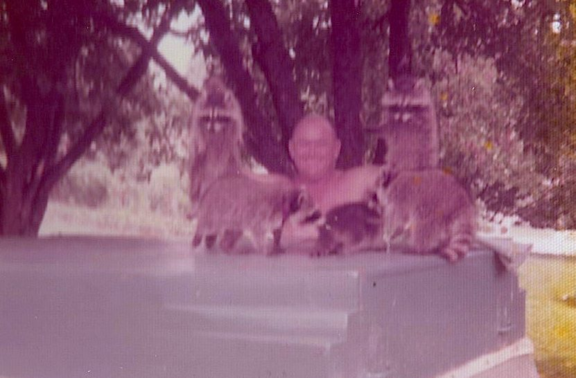 From photo's back: Holding Rascal and Mascal cause we couldn't keep them still. These on the camper have been sold but they were just as cuddly. Every one spoiled rotten. June 1975.
